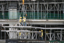 Construction Workers Working A...