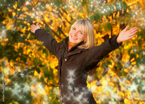 Fotografija  Happy young girl over abstract autumn background