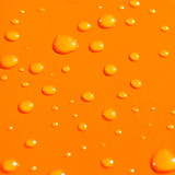 water drops on orange metal background