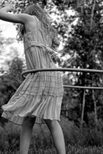 Old Fashioned Girl Twirling Hu...