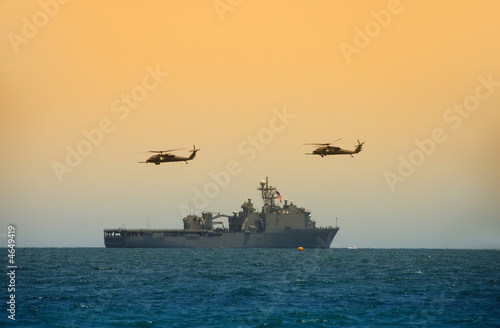 Canvas Print Navy battleship with hovering helicopters
