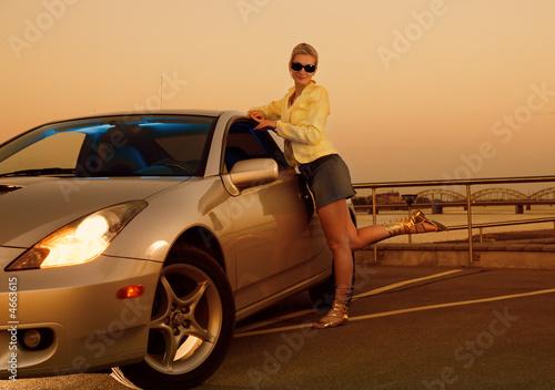 Fototapeta Sexy girl near the modern sport car obraz na płótnie