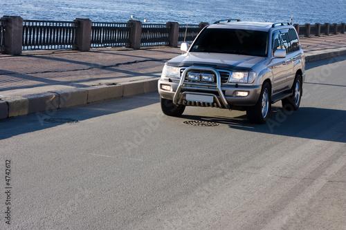 фотография big suv car drives on asphalt  of luxury cars series