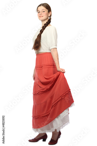 Obraz na plátně Young girl posing in red skirt