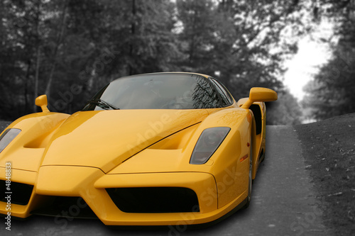 Foto auf Leinwand Yellow Super Car on a black and white road background