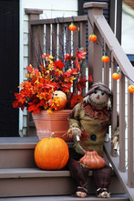 Scarecrow On Front Porch