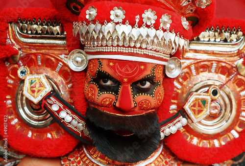 Photo Face Art  of Thekkan Kariyathan Theyyam During the Traditional Festival at Thal