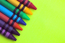 Wax Crayons On Yellow Background