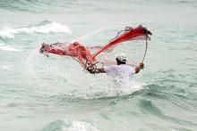 Man Casting Net