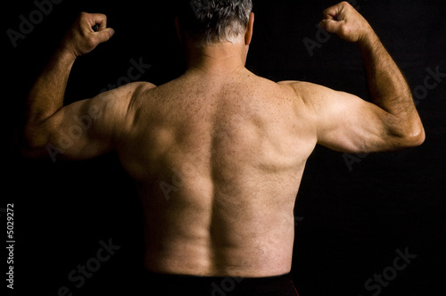 Photo  Old man flexing muscles