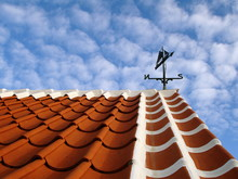 Traditional Red-tiled Skagen-roof With Weathervane On The Top And White-painted Sides