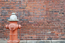 Brick Wall With Fire Hydrant