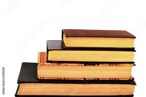 Pile of four old books Wallpaper Mural