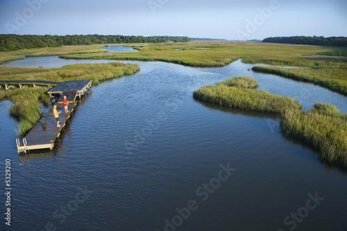 Valokuva Boys on dock in marsh.