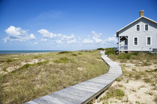 Beachfront House With Wooden Walkway.