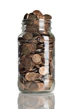 Jar Full Of Pennies And Dollar Bills