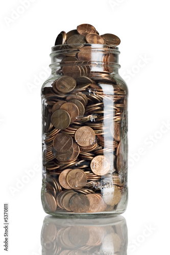 Fotografía  jar full of pennies and dollar bills