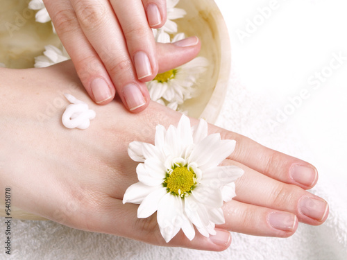 Poster Pedicure female applying cream to her hands