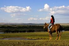 An Asian Girl Horse Riding At ...
