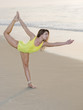 Young woman stretching on a beach