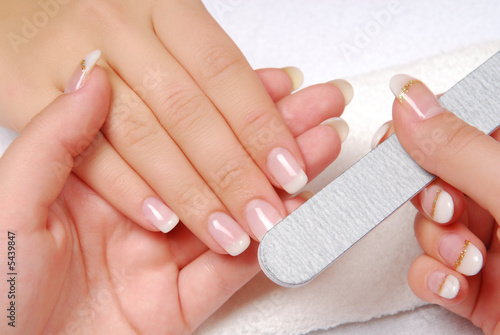 Staande foto Manicure Studio nail — beautician polishing female nails