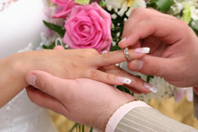 Bride And Groom Changing Wedding Rings