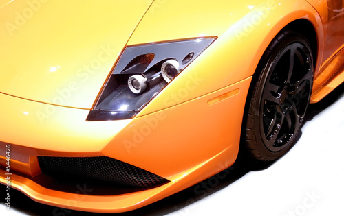 Fototapeta  Yellow sports car isolated on white background