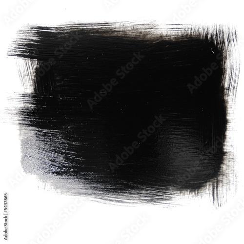 Photo peinture noire au pinceau isolée sur un arrière plan blanc
