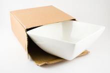Dish In Cardboard Box