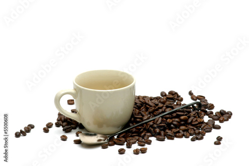 cup of coffee on coffees beans