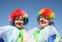 Two Bizzare Clowns In Colored ...