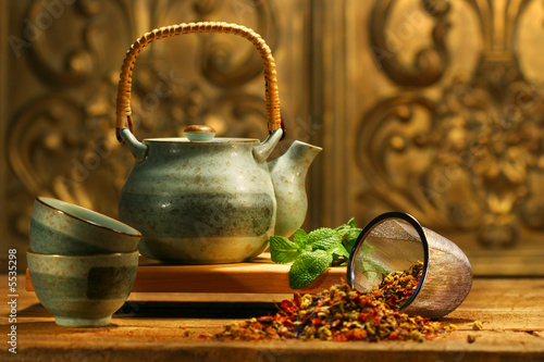 Asian herb tea on an old rustic table Canvas Print
