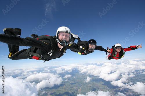 Fototapeta  Skydivers form a formation