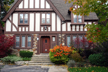 Tudor Style Home With Brown Tr...