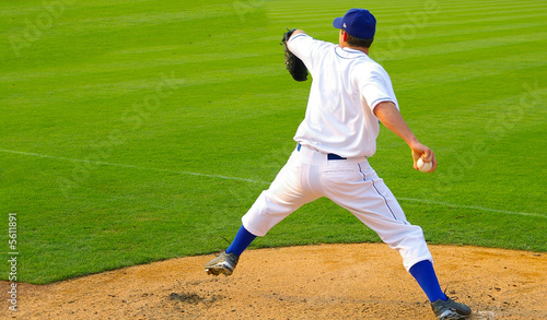 Fotografie, Obraz  Professional baseball pitcher throwing the ball