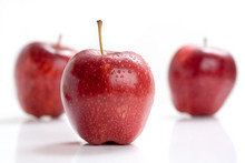 Red Apple With Water Drops On White