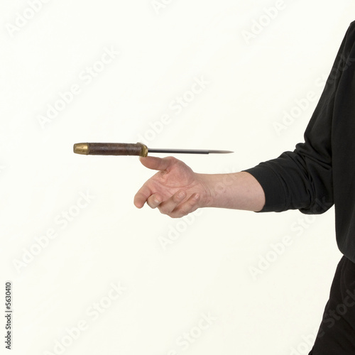 Flying knife - thrower's hand - Buy this stock photo and