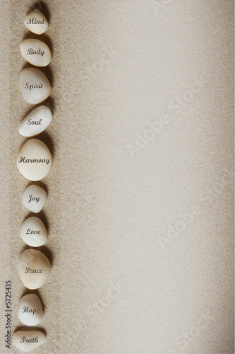 Wallpaper Mural Stones with words on sandy background