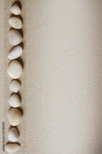 Photo sur Plexiglas Zen pierres a sable Sandy background with stones