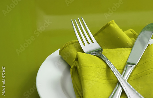 Fotografie, Obraz  An elegant holiday table setting with fork, knife and napkin