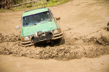 4x4 With A Snorkel Plowing Through A Mud Hole.