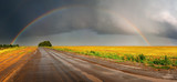 Fototapeta Tęcza - Landscape with country road and rainbow
