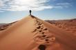 Leinwandbild Motiv Man go up in sand desert