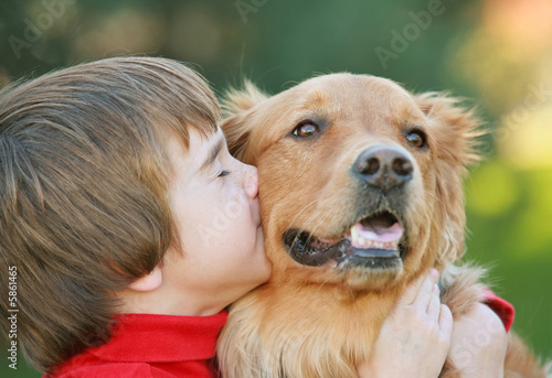 Photo  Boy Kissing Dog