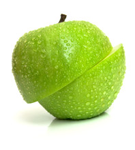 The Wet Green Apple Is Cut On Two Parts. Isolation On White