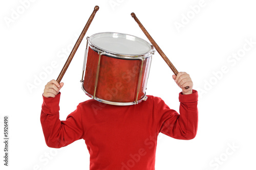 Fotografía  Child with a drum in the head a over white background