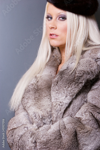 Sexy woman in fur coat