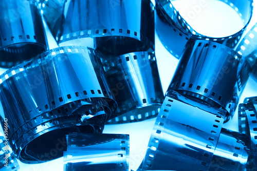 Fototapety, obrazy: Photographic film pieces. Blue tint.