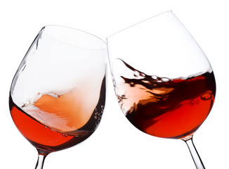 Fototapeta pair of moving wine glasses over a white background, cheers!