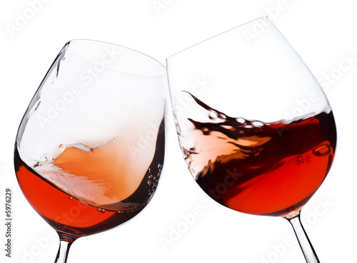Foto op Plexiglas Wijn pair of moving wine glasses over a white background, cheers!